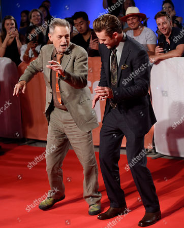 """Jonathan Demme, left, director of the concert film """"Justin Timberlake + The Tennessee Kids,"""" dances with star Justin Timberlake on the red carpet at the premiere of the film on day 6 of the Toronto International Film Festival at Roy Thomson Hall, in Toronto"""