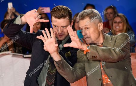 """Justin Timberlake, left, star of the concert film """"Justin Timberlake + The Tennessee Kids,"""" and director Jonathan Demme gesture at the premiere of the film on day 6 of the Toronto International Film Festival at Roy Thomson Hall, in Toronto"""