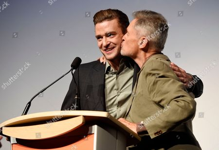 """Justin Timberlake, left, star of the concert film """"Justin Timberlake + The Tennessee Kids,"""" gets a kiss from director Jonathan Demme as they introduce the film at the premiere on day 6 of the Toronto International Film Festival at Roy Thomson Hall, in Toronto"""