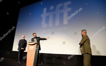"""Justin Timberlake, center, star of the concert film """"Justin Timberlake + The Tennessee Kids,"""" introduces the film alongside producer Gary Goetzman, left, and director Jonathan Demme at the premiere on day 6 of the Toronto International Film Festival at Roy Thomson Hall, in Toronto"""