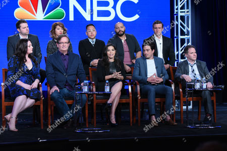 """The cast and crew of """"Superstore"""" participate in a panel at the NBCUniversal Winter TCA, in Pasadena, Calif. Pictured, from back row left, are executive producer David Bernad, Nichole Bloom, Nico Santos, Colton Dunn, executive producer Ruben Fleischer, and from front row left, Lauren Ash, Mark McKinney, America Ferrera, Ben Feldman and executive producer Justin Spitzer"""