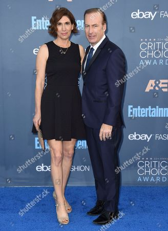 Naomi Odenkirk, left, and Bob Odenkirk arrive at the 22nd annual Critics' Choice Awards at the Barker Hangar, in Santa Monica, Calif
