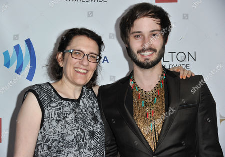 Jane Espenson, left, and Brad Bell arrive at the 25th Annual GLAAD Media Awards on