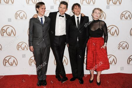 From left, Ellar Coltrane, Ethan Hawke, Richard Linklater, and Cathleen Sutherland arrive at the 26th Annual Producers Guild Awards, in Los Angeles