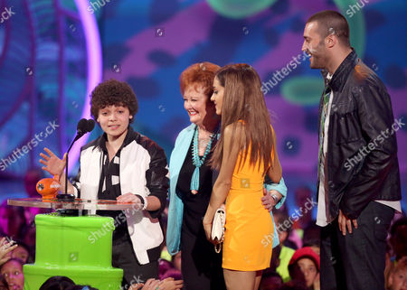 From left, Cameron Ocasio, Maree Cheatham, Ariana Grande, and Zoran Korach accept the award for favorite TV show for Sam & Cat at the 27th annual Kids' Choice Awards at the Galen Center, in Los Angeles