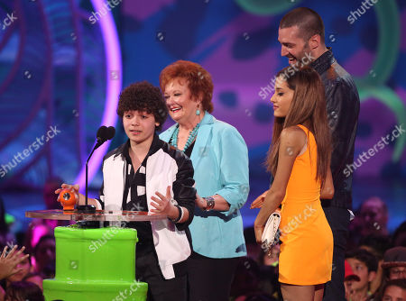 From left, Cameron Ocasio, Maree Cheatham, Ariana Grande, and Zoran Korach accept the award for favorite TV show for â?oeSam & Catâ?? at the 27th annual Kids' Choice Awards at the Galen Center, in Los Angeles