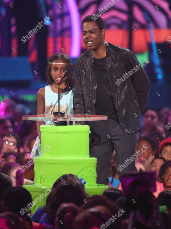 Stock Photo of Chris Rock, right, and daughter Lola Simone Rock present the favorite TV actress award at the 27th annual Kids' Choice Awards at the Galen Center, in Los Angeles