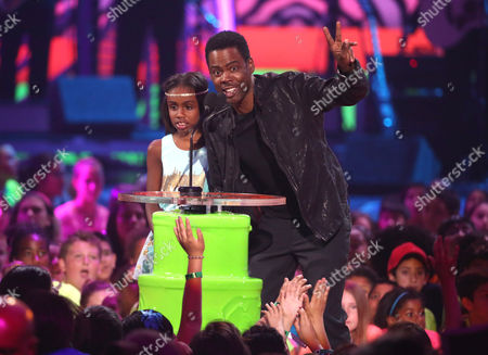 Lola Simone Rock, left, and Chris Rock present the favorite TV actress award at the 27th annual Kids' Choice Awards at the Galen Center, in Los Angeles