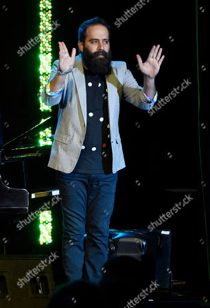 Sebu Simonian of the band Capital Cities acknowledges the audience after performing at the 32nd Annual ASCAP Pop Music Awards at the Loews Hollywood Hotel, in Los Angeles
