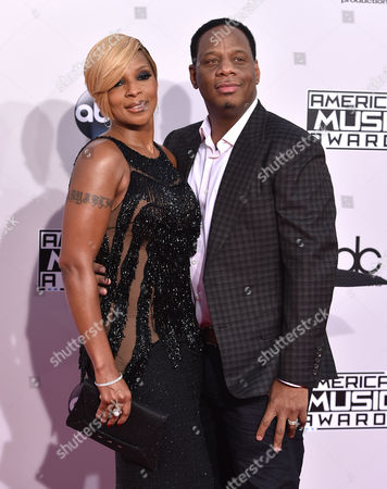 Mary J. Blige, left, and Kendu Isaacs arrive at the 42nd annual American Music Awards at Nokia Theatre L.A. Live, in Los Angeles