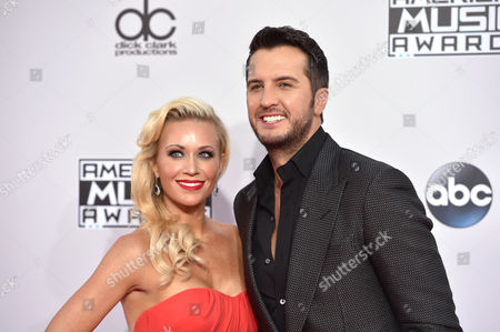 Caroline Boyer, left, and Luke Bryan arrive at the 42nd annual American Music Awards at Nokia Theatre L.A. Live, in Los Angeles