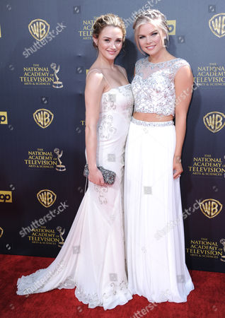Hunter King, left, and Kelli Goss arrive at the 42nd annual Daytime Emmy Awards at Warner Bros. Studios, in Burbank, Calif