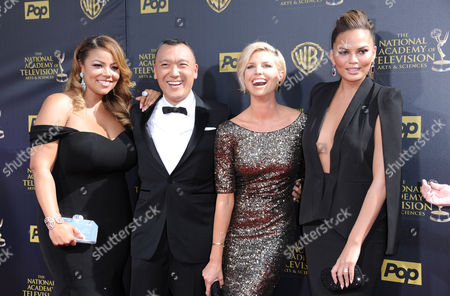Lauren Makk, from left, Joe Zee, Leah Ashley, and Chrissy Teigen arrive at the 42nd annual Daytime Emmy Awards at Warner Bros. Studios, in Burbank, Calif