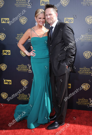 Stock Image of Nancy O'Dell, left, and Keith Zubulevich arrive at the 42nd annual Daytime Emmy Awards at Warner Bros. Studios, in Burbank, Calif