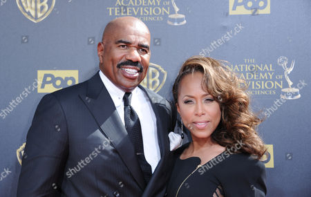 Steve Harvey, left, and Marjorie Bridges-Woods arrive at the 42nd annual Daytime Emmy Awards at Warner Bros. Studios, in Burbank, Calif