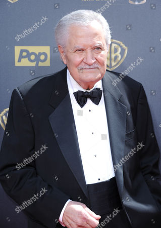 Stock Photo of John Aniston arrives at the 42nd annual Daytime Emmy Awards at Warner Bros. Studios, in Burbank, Calif