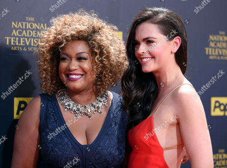 Sunny Anderson, left, and Katie Lee arrive at the 42nd annual Daytime Emmy Awards at Warner Bros. Studios, in Burbank, Calif