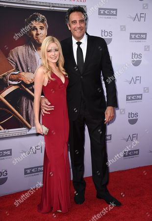 Stock Photo of IsaBeall Quella, left, and Brad Garrett arrive at the 43rd AFI Lifetime Achievement Award Tribute Gala at the Dolby Theatre, in Los Angeles