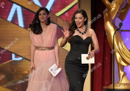 Camila Banus, left, and Teresa Castillo present the award for outstanding entertainment program in Spanish at the 43rd annual Daytime Emmy Awards at the Westin Bonaventure Hotel, in Los Angeles
