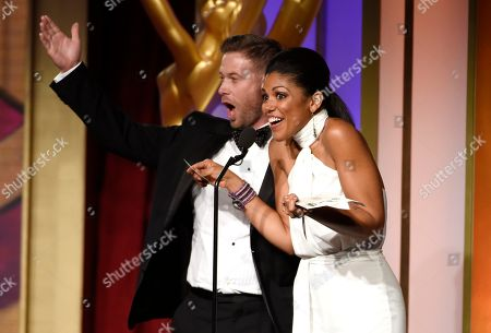 Jacob Young, left, and Karla Mosley present the award for outstanding writing in a drama series at the 43rd annual Daytime Emmy Awards at the Westin Bonaventure Hotel, in Los Angeles
