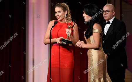 Maria Alejandra Requena, from left, Alejandra Oraa, and Eduardo Suarez accept the award for outstanding morning show in Spanish for Cafe CNN at the 43rd annual Daytime Emmy Awards at the Westin Bonaventure Hotel, in Los Angeles