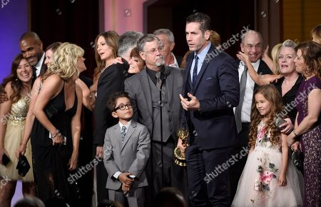Frank Valentini, center, and the cast and crew of General Hospital accept the award for outstanding drama series for General Hospital at the 43rd annual Daytime Emmy Awards at the Westin Bonaventure Hotel, in Los Angeles