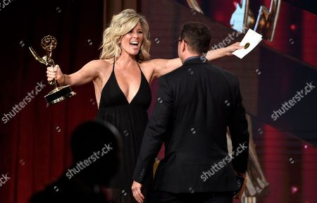 Laura Wright, left, presents Tyler Christopher with the award for outstanding lead actor for General Hospital at the 43rd annual Daytime Emmy Awards at the Westin Bonaventure Hotel, in Los Angeles