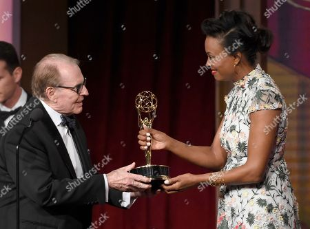 Aisha Tyler, right, presents Charles Osgood with the award for outstanding morning program for CBS Sunday Morning at the 43rd annual Daytime Emmy Awards at the Westin Bonaventure Hotel, in Los Angeles