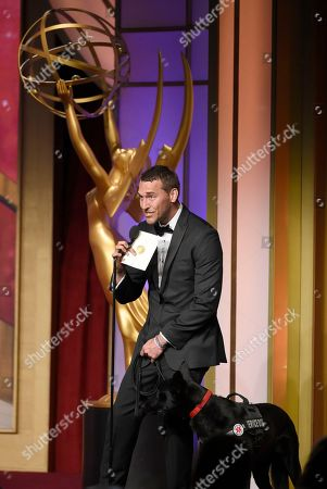 Brandon McMillan presents the award for outstanding younger actress at the 43rd annual Daytime Emmy Awards at the Westin Bonaventure Hotel, in Los Angeles