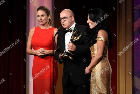 Maria Alejandra Requena, from left, Eduardo Suarez, and Alejandra Oraa accept the award for outstanding morning show in Spanish for Cafe CNN at the 43rd annual Daytime Emmy Awards at the Westin Bonaventure Hotel, in Los Angeles
