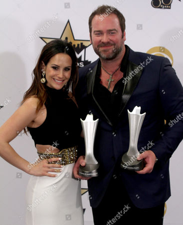 """Lee Brice, right, poses in the press room with Sara Reeveley and the awards for single record of the year for """"I Don't Dance"""" at the 50th annual Academy of Country Music Awards at AT&T Stadium, in Arlington, Texas. Brice won the awards as a producer and a singer"""