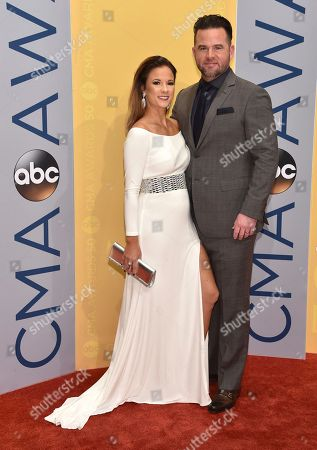 Catherine Werne, left, and David Nail arrive at the 50th annual CMA Awards at the Bridgestone Arena, in Nashville, Tenn
