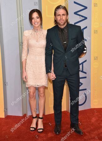 Canaan Smith, right, and Christy Hardesty Smith arrive at the 50th annual CMA Awards at the Bridgestone Arena, in Nashville, Tenn