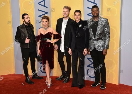 Avi Kaplan, from left, Kirstin Maldonado, Scott Hoying, Mitch Grassi and Kevin Olusola, of Pentatonix, arrive at the 50th annual CMA Awards at the Bridgestone Arena, in Nashville, Tenn