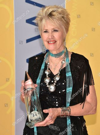Janie Fricke, winner of the female vocalist of the year award in 1983, arrives at the 50th annual CMA Awards at the Bridgestone Arena, in Nashville, Tenn