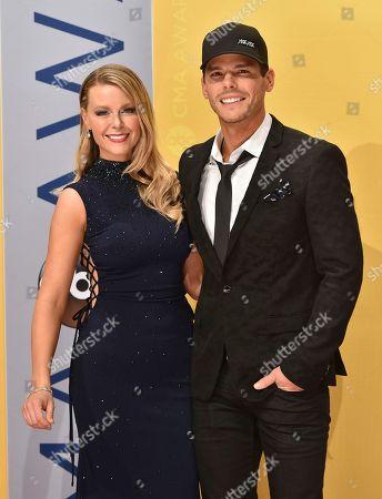 Amber Bartlett, left, and Granger Smith arrive at the 50th annual CMA Awards at the Bridgestone Arena, in Nashville, Tenn
