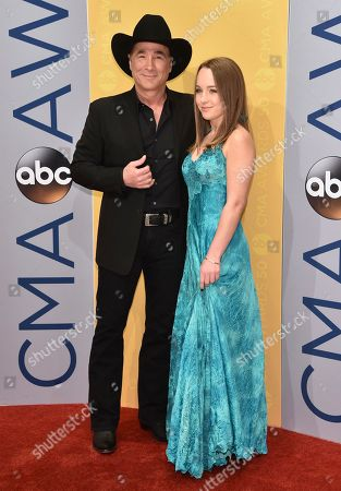 Clint Black, left, and Lily Pearl Black arrive at the 50th annual CMA Awards at the Bridgestone Arena, in Nashville, Tenn