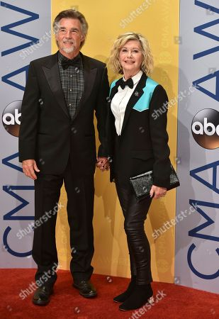 Olivia Newton-John, right and John Easterling arrive at the 50th annual CMA Awards at the Bridgestone Arena, in Nashville, Tenn
