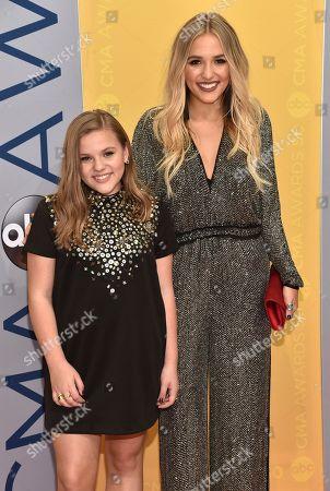 Maisy Stella, left, and Lennon Stella of Lennon & Maisy arrive at the 50th annual CMA Awards at the Bridgestone Arena, in Nashville, Tenn