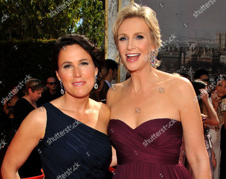SEPTEMBER 18: Dr. Lara Embry and Jane Lynch arrive at the Academy of Television Arts & Sciences 63rd Primetime Emmy Awards at Nokia Theatre L.A. Live on in Los Angeles, California