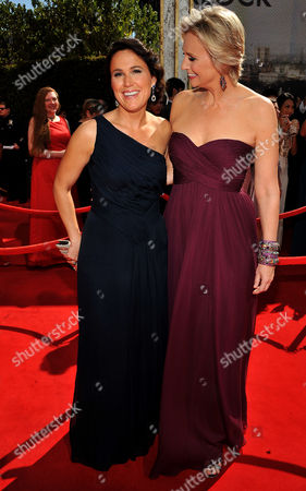 Stock Image of SEPTEMBER 18: Dr. Lara Embry and Jane Lynch arrive at the Academy of Television Arts & Sciences 63rd Primetime Emmy Awards at Nokia Theatre L.A. Live on in Los Angeles, California