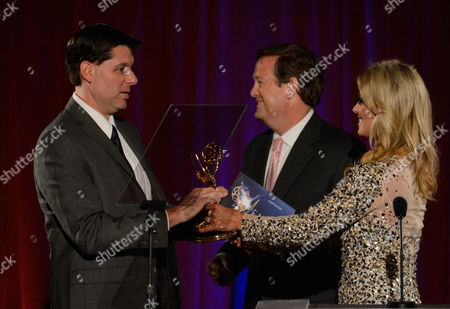 """AUGUST 11: KTTV Reporter Courtney Friel and KTLA Reporter Sam Rubin present the """"Sports Feature"""" award to producers Bruce Beffe, Tony Stefanelli and Christopher Witte of FOX Sports West for '50 Years Under The Halo: 2009 (50 Years Under The Halo)'onstage at the Academy of Television Arts & Sciences 64th Los Angeles Area Emmy Awards on in Los Angeles, California"""