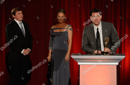 "NORTH HOLLYWOOD, CA - AUGUST 11: Reporters Joe McDonald and Tamara Henry present the ""Sports Series - Programming"" award to the FOX Sports West Sports Team for FOX Sports West's '50 Years Under The Halo: 1970, 2009, 2002' onstage at the Academy of Television Arts & Sciences 64th Los Angeles Area Emmy Awards on in Los Angeles, California"