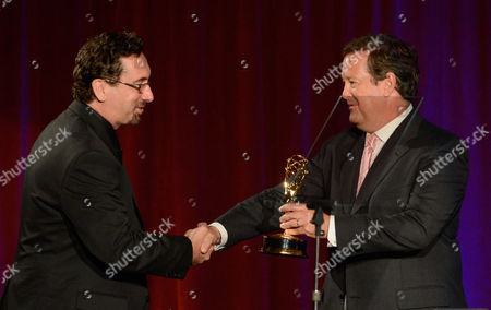"""NORTH HOLLYWOOD, CA - AUGUST 11: KTTV Reporter Courtney Friel and KTLA Reporter Sam Rubin present the """"Sports Tease"""" award to producers James Freeman and Damion Tinsley of Prime Ticket for 'Ducks Home Opener Tease - Chemistry' onstage at the Academy of Television Arts & Sciences 64th Los Angeles Area Emmy Awards on in Los Angeles, California"""