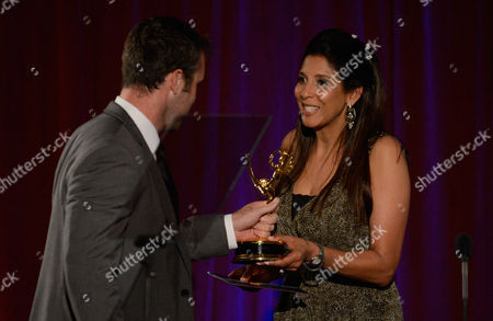 """NORTH HOLLYWOOD, CA - AUGUST 11: News Anchor Christine Devine presents the """"Light News Story - Multi-Part Report' award to Camera James McCann of KTLA5 for 'Kids Count' onstage at the Academy of Television Arts & Sciences 64th Los Angeles Area Emmy Awards on in Los Angeles, California"""