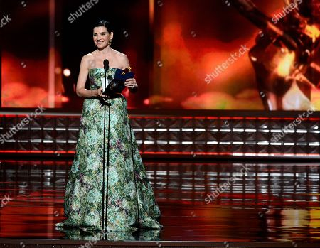 SEPTEMBER 23: Julianna Marguiles presents the Outstanding Lead Actor in a Drama Series award onstage at the Academy of Television Arts & Sciences 64th Primetime Emmy Awards at Nokia Theatre L.A. Live on in Los Angeles, California