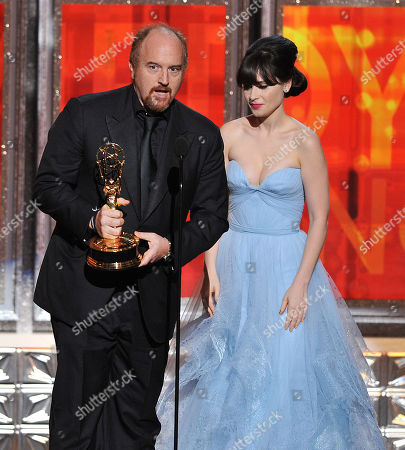 "SEPTEMBER 23: Louis C. K. (L), winner of the Outstanding Writing For A Comedy Series award to for ""Louie"" and presenter Zooey Deschanel (R) onstage at the Academy of Television Arts & Sciences 64th Primetime Emmy Awards at Nokia Theatre L.A. Live on in Los Angeles, California"