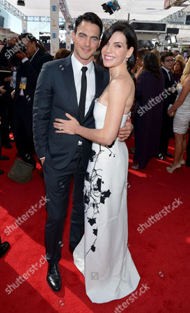 Stock Photo of From left, Keith Lieberthal and Julianna Marguiles arrive at the 65th Primetime Emmy Awards at Nokia Theatre, in Los Angeles