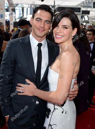 From left, Keith Lieberthal and Julianna Marguiles arrives at the 65th Primetime Emmy Awards at Nokia Theatre, in Los Angeles
