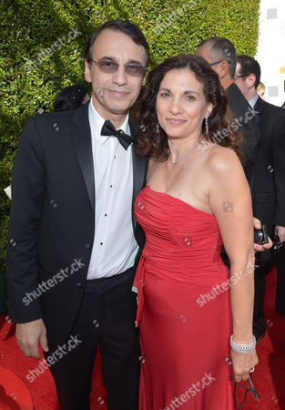 Academy governor Frank Morrone, left and wife arrive at the 65th Primetime Emmy Awards at Nokia Theatre, in Los Angeles